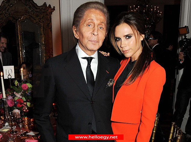 The future's bright for Victoria Beckham as she switches things up in a stylish orange skirt suit for fashion talk