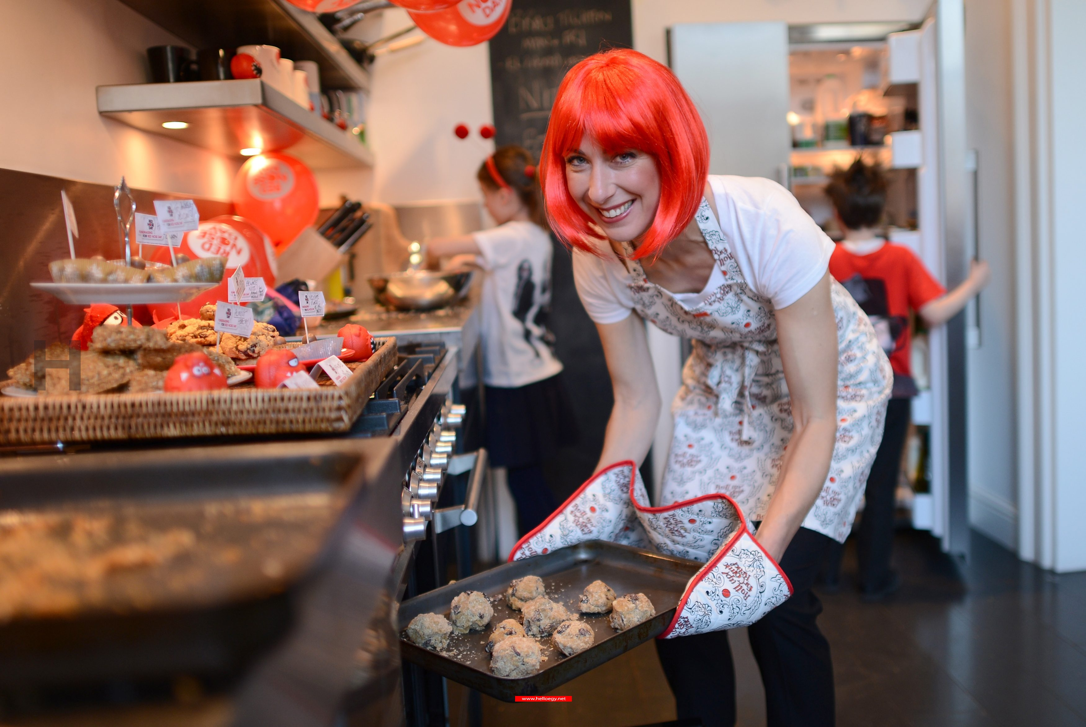 Samantha Cameron Wears A Red Wig And Bakes Cakes For Comic Relief