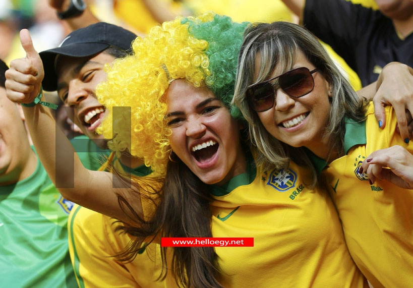 Soccer-Brazil beat Japan but protests spoil opening day